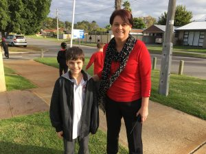 Mrs Schicker and Cameron on their walk around the school.